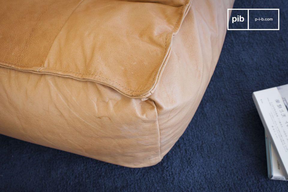 Der Ledersessel Matignon kombiniert die Vorteile beider Möbelstücke