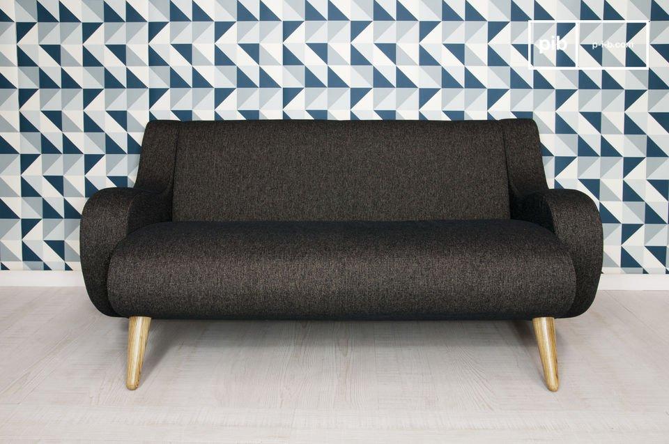 Dieses auf einem Untergestell aus massiver Esche thronende  Designer-Sofa   verfügt über breite
